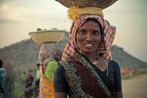 Woman carrying load on her head