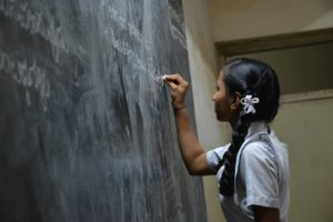 girl in classroom/school